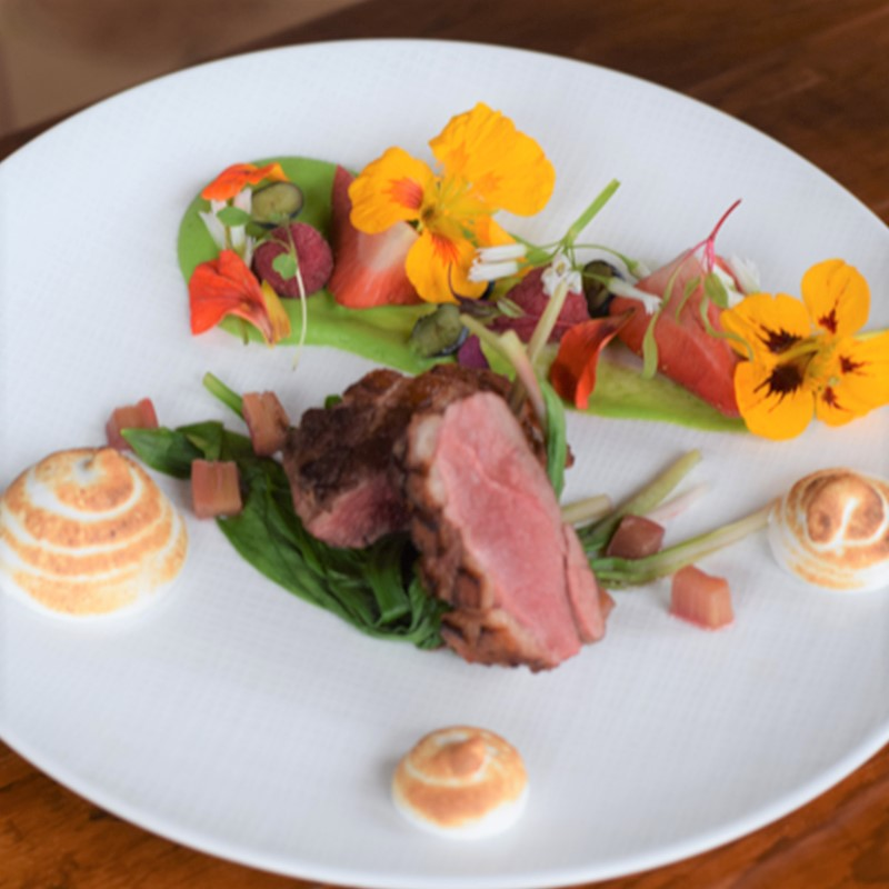 Lake Placid Lodge - image depicts a duck breast meal on a plate