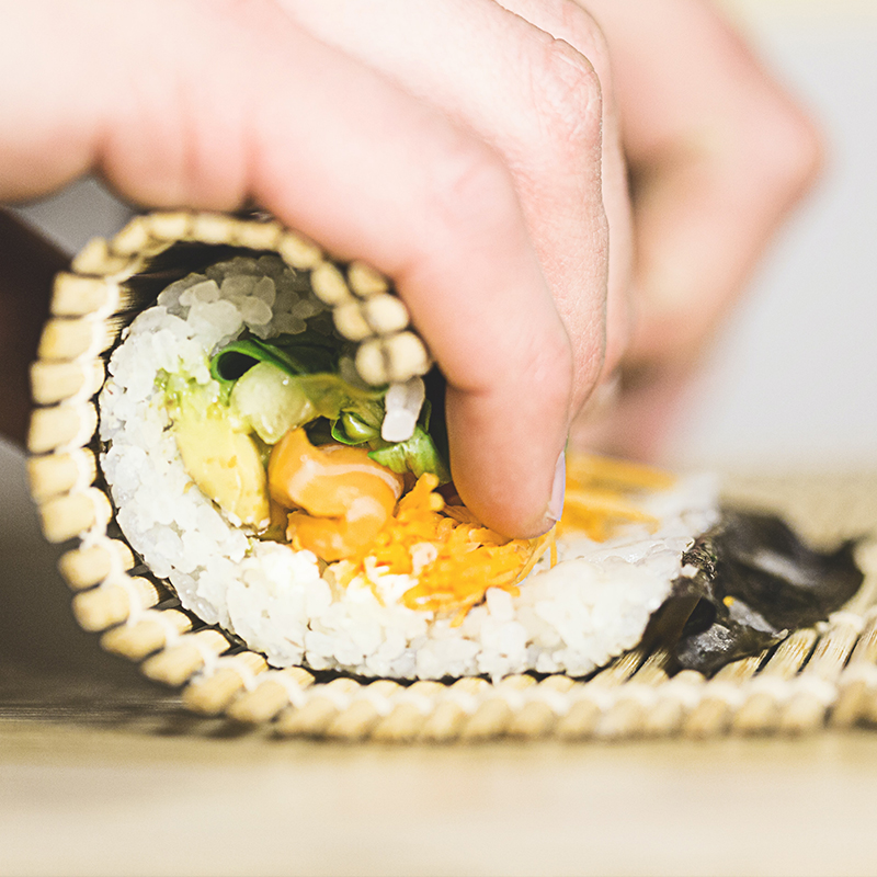 Image sushi being rolled